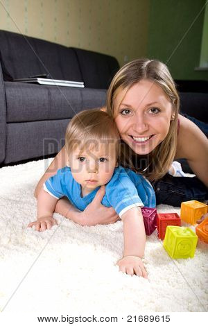 Young Mother Playing With Baby Boy