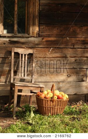 Old Chair And Apples