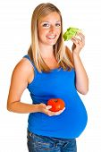 Pregnant woman with vegetables isolated on white