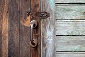 Old Wooden Doors With Bronze Handles And Keyhole. poster