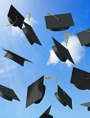stock photo of graduation cap  - A picture of a sky full of mortar boards - JPG