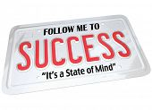A white metal license plate with the words Follow Me to Success, It's a State of Mind. Meant for aut