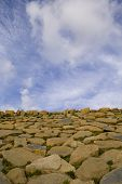 picture of fieldstone-wall  - a rock pattern and sky and a cloudy sky - JPG