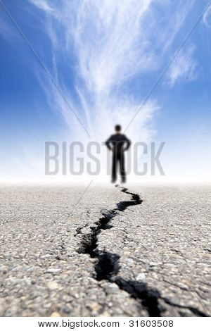 Business man Stand On The Crack Road