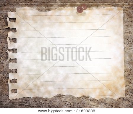 tear paper for short note on wood texture background
