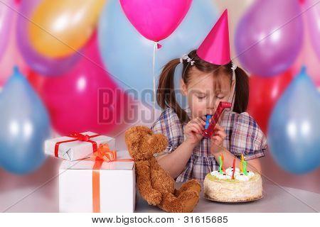 Little Girl Blowing In Tubule