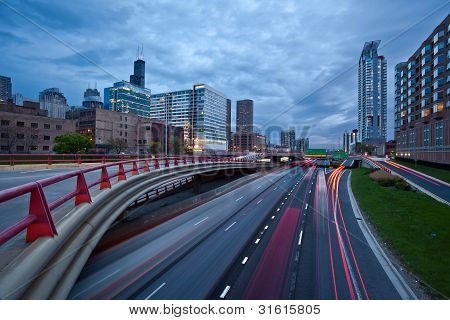 Busy city highway at twilight.