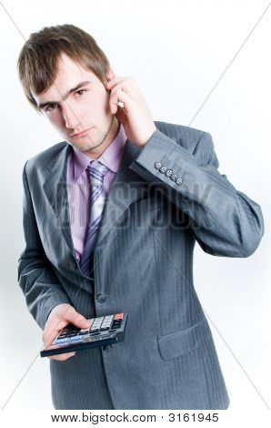Serious Looking Businessman With Calculator