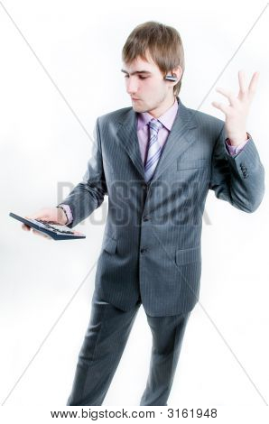 Upset Businessman With Calculator