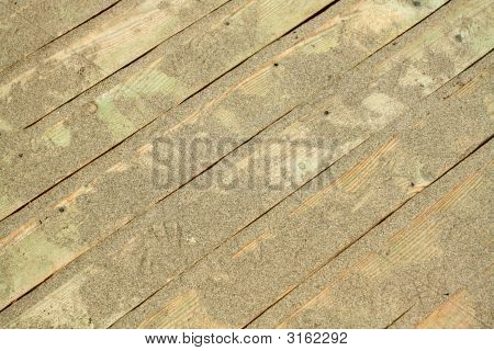 Golden Sands On The Wooden Floor