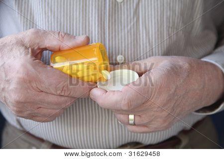 senior man taking prescription pills