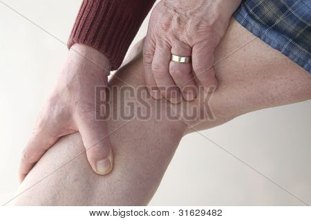 man checks pain in his leg