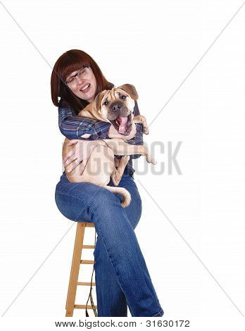 Woman Holding Dog.