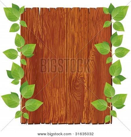 Wooden Board With Green Leaves