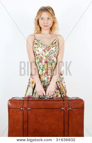 Girl With Vintage Suitcase Anticipating Travel