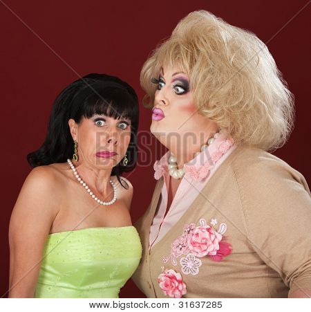 Drag Queen Kisses A Woman