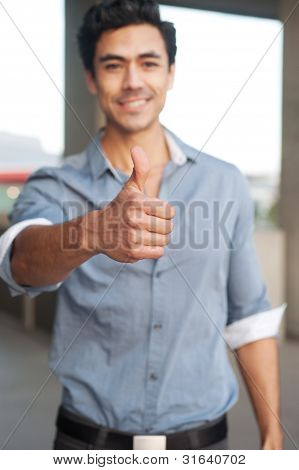 Young, Handsome Businessman Giving Thumbs Up