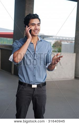 Handsome, Young Latino Businessman On Phone
