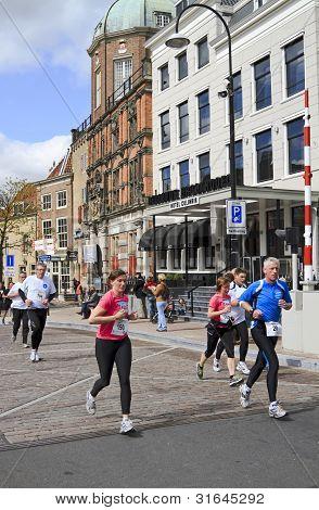 Runners Passing Bellevue Groothoofd Hotel