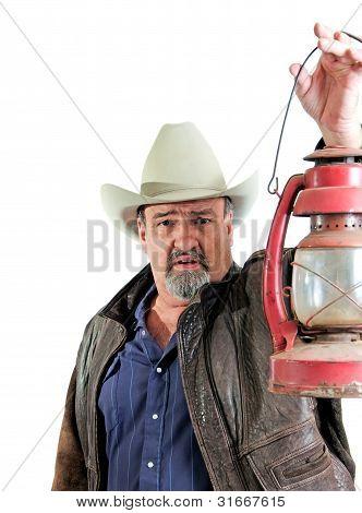 Adult Male Cowboy Holding Lantern