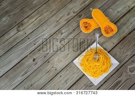 poster of Top View Of Healthy Butternut Squash Noodles With Fork Stuck In Pasta