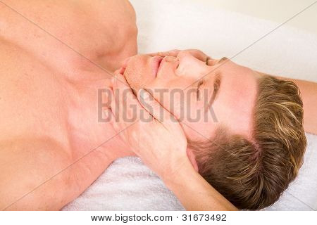 Young Man Receives A Face Massage