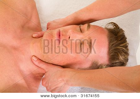 Young Man Receives A Neck Massage