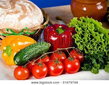 vegetables,bread and dishes on the table