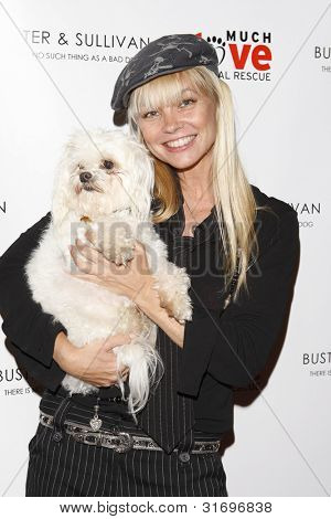 LOS ANGELES, CA - AUG 2: Julie McCullough at the opening of the new Upscale Doggie Boutique Buster & Sullivan in the Malibu Country Mart on August 2, 2007 in Malibu, California