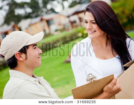 Man delivering a package and asking for signature