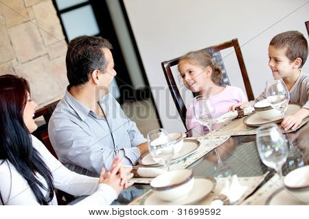 Happy family having dinner in the dinning room