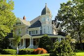 stock photo of wrap around porch  - Large and elegant Victorian house circa 1940.  Wrap-around porch, 3-story belvedere, manicured landscaping.