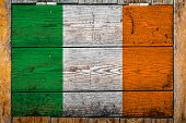 National Flag Of Ireland On A Wooden Wall Background.the Concept Of National Pride And Symbol Of The poster