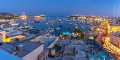 Aerial Panoramic View Of The Harbor Of Mediterranean Fishing Village Marsaxlokk At Night, Malta poster