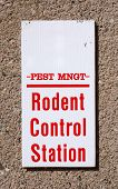 picture of pest control  - Sign reading Pest Mgmt Rodent Control Station on a wall - JPG
