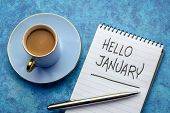 Hello January - handwriting in a notebook with a cup of coffee poster