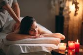 Spa, Massage. Young Dark-haired Beautiful Girl Doing Massage. poster