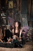 picture of faerie  - Sad Faery sitting in suitcase holding Jeweler glasses - JPG