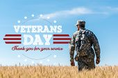 Soldier In Military Uniform With Backpack Standing In Field With Golden Wheat With Veterans Day, Tha poster
