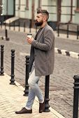 Waiting For Someone In Street. Man Bearded Hipster Drink Coffee Paper Cup. Businessman Well Groomed  poster