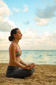 Lotus Yoga Pose. Close Up. Yoga At The Beach. Young Woman Sitting On Sand, Meditating, Practicing Yo poster