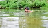 Summer Vibes. Mature Swimmer. Brutal Hipster With Wet Beard. Refreshing In River Water. Water Beast. poster