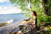 A Woman Is Meditating By The River Emotional Meditating Lifestyle. Introspection Relaxing poster