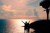 Silhouette Of Couple With Seascape Of Phuket Best View Point Sunset At Phrom Thep Cape. One Of Attra poster