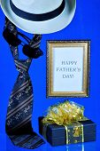Happy Fathers Day-tie, Hat And Gift On Creative Blue Background. An Annual Celebration In Honor Of  poster