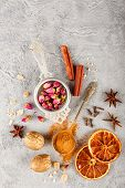 Different Kinds Of Spices - Cinnamon, Anise Stars, Cloves, Walnuts, Dried Orange Slices, Caramelized poster