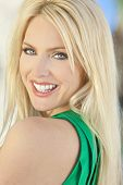 pic of blue eyes  - Natural light portrait of a happy smiling beautiful blond woman with blue eyes - JPG