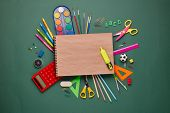 Blank writing-book with marker and stationery accessories: pencils, pens, other office supplies on g poster