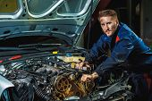 Close Up Hands Of Unrecognizable Mechanic Doing Car Service And Maintenance. Mechanic Working In Car poster