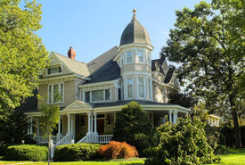 picture of victorian houses  - Large and elegant Victorian house circa 1940.  Wrap-around porch, 3-story belvedere, manicured landscaping.
